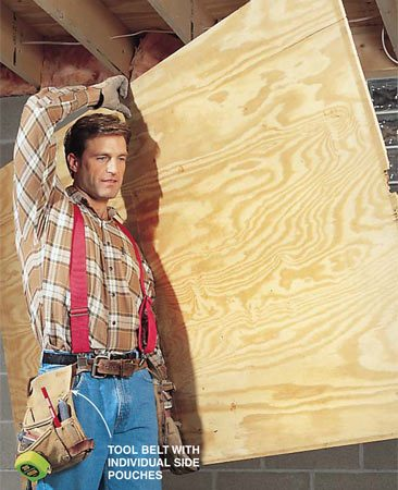<b>Photo 6: Ease your load</b></br> Use suspenders to distribute the weight of your tools and fasteners. For even better back support, buy tool pouches with a padded belt that can be rigged with or without harness- type suspenders. Avoid injuries by practicing proper techniques for lifting and carrying plywood and other heavy materials.