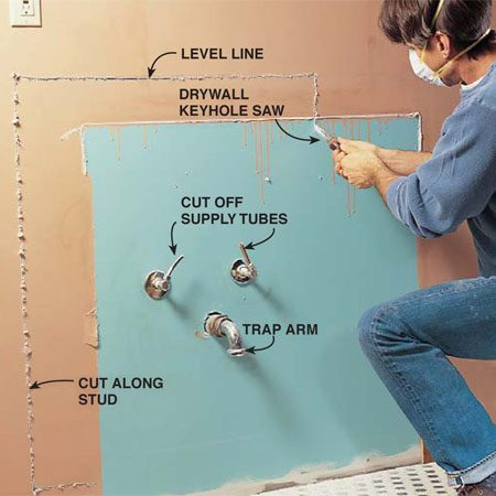 <b>Photo 2: Cut open the wall</b></br> Cut out the drywall (or plaster) to expose the plumbing and allow access for installing wood backing. Cut along the edge of the studs. <strong>Caution:</strong> Keep your saw blade shallow to avoid hitting electrical wires.