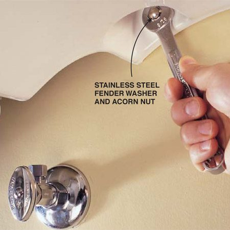 <b>Photo 15: Install the sink</b></br> Screw the pedestal base to the floor. Slide the sink over the mounting bolts and install a stainless steel fender washer and acorn nut to secure it. Be careful not to overtighten the nut or you could break the sink.