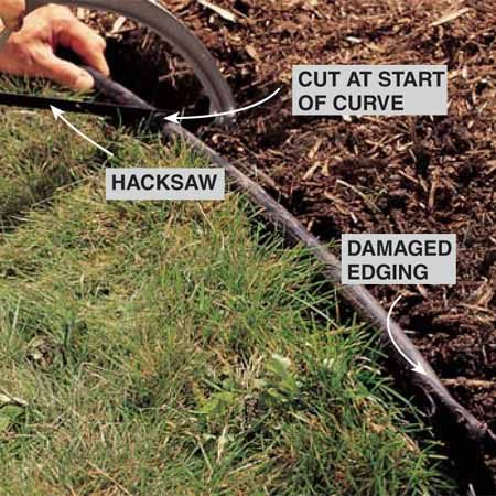 <b>Photo 1: Saw the old edging</b></br> Saw through the edging after removing the soil and mulch on both sides. If the damage is on a curved area, cut farther back to where the edging runs straight so the newly installed piece can make a more natural, graceful curve.