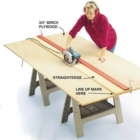 <b>Photo 1: Build a cutting jig</b></br> Cut your plywood shapes from 3/4-in. sheets of hardwood plywood. Use a homemade straightedge made from 3/4-in. plywood strips clamped to the sheet for super-straight cuts.  To make a simple cutting jig, cut a 4-in. strip with the factory edge from an 8-ft length of 3/4-in. plywood.  Then cut a 12-in. strip from the same piece (without the factory edge).  Screw the 4-in. strip to one side of the larger piece, lining up the cut edges.  Then cut the larger piece, using the factory edge of the 4-in. piece as a guide.  You now have a perfectly straight cutting jig sized exactly to your circular saw. To make cuts, just align the edge of the wider piece with the mark you want to cut.