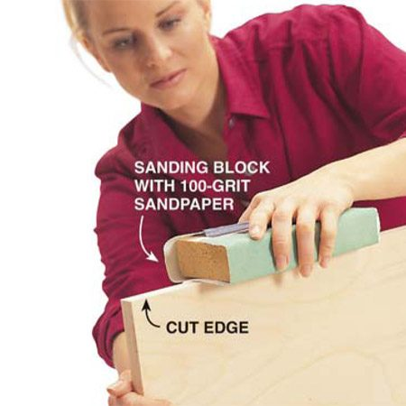 <b>Photo 2: Sand lightly</b></br> Sand any rough edges of the plywood smooth and flat to make an even surface for the thin adhesive-backed birch edge banding. Be careful not to round the edges.