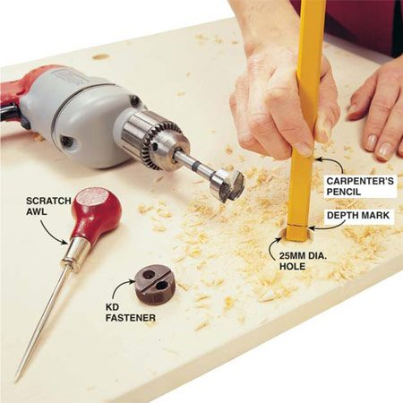 <b>Photo 5: Drill holes for fasteners</b></br> Mark the hole centers with a scratch awl, then drill the holes for the knockdown fasteners with a special 25mm Forstner bit.