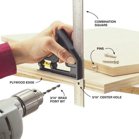 <b>Photo 7: Drill pin holes</b><br/>Make this simple hole-alignment jig from a combination square: Just drill a 3/16-in. hole in the center of the square blade anywhere along the length. Set the square so the hole lines up with the center of the plywood edge. Lock it in place. Now drill through this hole about 1 in. deep into the plywood edge with a 3/16-in. brad point drill bit. It's best to use a brad point drill bit, because it has a center point that keeps the bit from wandering as you drill.