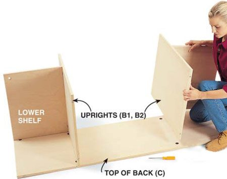 <b>Photo 11: Fasten plywood pieces together</b></br> Join the lower shelves to the uprights first, then attach these assemblies to the back. Finally, insert the pins into the fasteners, then turn the screws until the wood panels pull together tightly.