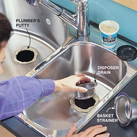 <b>Photo 4: Putty and set the drain baskets</b></br> Roll plumber's putty into a 1/2- in. dia. rope and form it around each drain opening. Press the top half of the basket strainer assembly down into the plumber's putty on one side. On the other, press the disposer drain down into the putty.