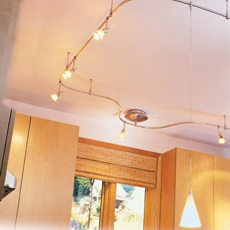 <b>Low voltage track lighting system</b></br> With this system you bend the track to fit your kitchen layout and add spotlights or hanging light fixtures anywhere along the track.