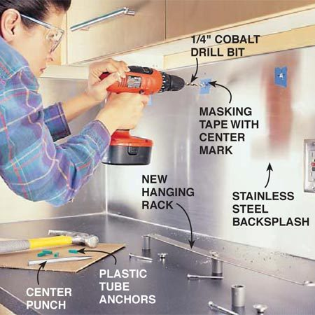 <b>Photo 16: Drill and mount the rack</b></br> Drill holes in the metal to mount the utensil rack. Measure up from the counter and mark pieces of tape for the center of the holes. Use a center punch and hammer to make a small divot in the center of each mark. Place the tip of the bit in the divot and drill very slowly with heavy pressure. Use a special cobalt bit to drill stainless steel ( buy it at home centers).