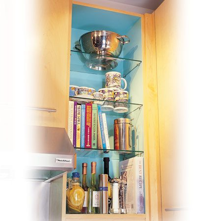 <b>Cabinet conversion to open shelving</b></br> Converting a cabinet or two to open shelves breaks up that intimidating bank of doors, opens up space and becomes a nice display area for attractive bowls and china.