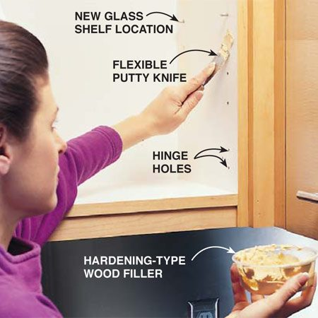 """<b>Photo 17: Fill hinge holes</b></br> Remove the cabinet doors and hinges. Fill all extra shelf bracket or hinge holes with a hardening-type wood filler. Allow this to harden, sand it smooth, and apply a coat of lightweight surfacing compound to fill low spots left after the wood filler shrinks. Let the second coat dry. Then sand the entire cabinet interior with 80-grit paper to provide a """"rough"""" surface for the paint to grab."""