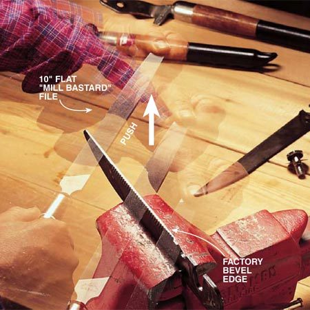 <b>Photo 2: File the edge to expose clean metal</b></br> Clamp the blade firmly in a vise. Examine the factory edge. Hold the file with both hands and mimic the direction of the bevel like a golfer taking a practice putt. Now move the file in one broad stroke away from you along the entire cutting angle. To reiterate, move the file in one direction, away from you. Don't use small, jerky strokes or you'll lose the factory edge. As you work, you can see the clean metal path left by the file. Adjust your angle as needed to file the entire edge evenly. Repeat this motion several times until you expose clean metal over the whole edge. Usually it'll take only about 10 strokes. Do the same with the other blade.