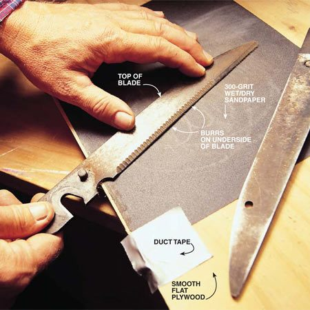 <b>Photo 3: Sand the back side of the blade</b></br> Place a sheet of 300-grit wet/dry sandpaper on a smooth, flat piece of plywood. You'll be able to feel the burrs (be careful—they're sharp) on the back side of each blade caused by the filing action. To remove them, lightly sand the back side of the blade. Keep the blade flat and move it in a circular motion. After making several circles, pick up the blade and gently feel the edge. When the burrs left by the file disappear, assemble the blades and lightly oil the moving parts with 3-In-One oil. Then try a test cut with the shears. They should cut better than ever.