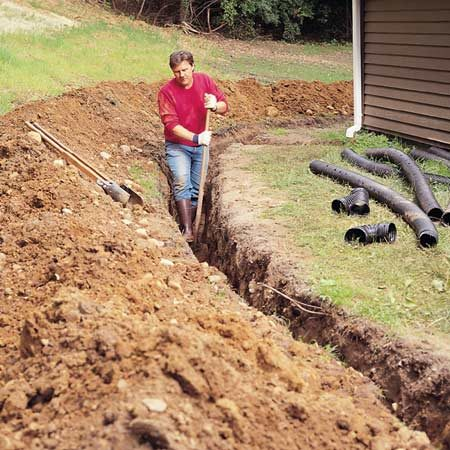 <b>Dig the trench</b></br> Start by digging a deep trench for the drain tile.