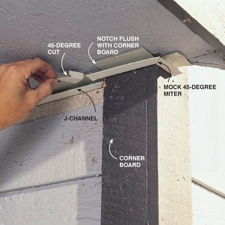 <b>Photo 2: Install aluminum J-channel</b></br> Nail J-channel against the existing soffit into the soffit framing. On corners, notch the top and backside of the J-channel the width of corner boards and cut the bottom to extend past corner boards the width of the next piece. Cut a 45-degree angle on adjoining pieces to give a mock miter appearance to corners.