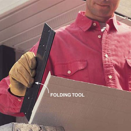 <b>Photo 13: Bend corners crisply</b></br> Bend the ends of horizontal fascias with a 12-in. folding tool to cleanly wrap around corners. Hold corners tight with two nails.