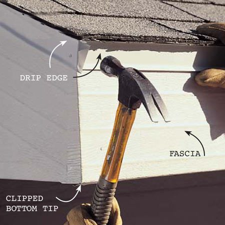 <b>Photo 15: Install the drip edge</b></br> Slip drip edge under all roofing material and face-nail it through the fascia. Notch the tops of corners to interlock flanges and bend the bottom around for a neat appearance.