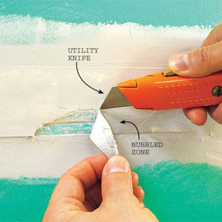 <b>Photo 14: Cut bubbled tape out</b></br> Use a sharp utility knife  and recoat the area with compound. Don't try to hide bubbles with a heavy layer  of compound.  They always show through.