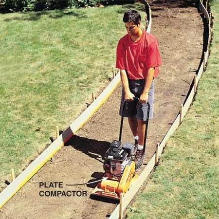 <b>Photo 6: Pack the soil </b></br> Pack the underlying soil with a plate compactor (rental). It's important to uniformly pack the entire base (including the sides near the forms).