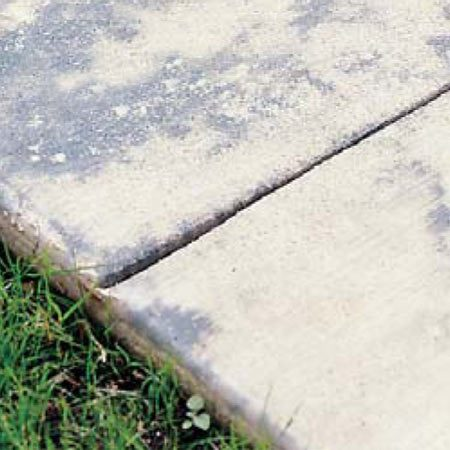 <b>Photo 18: Mottling eventually disappears </b></br> The grayish-blue mottling on this concrete surface is caused by the plastic contacting the concrete unevenly, especially in direct sunlight. The mottling disappears eventually.