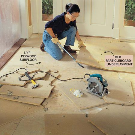 <b>Photo 1: Tear out old flooring</b></br> Tear out old hardwood flooring, ceramic tile or carpet and underlayment to allow extra room for the mortar bed and tile. This will minimize level changes at the openings into other rooms. Cut flooring or underlayment into smaller pieces to make them easier to remove. Make sure to leave subfloor fully intact. Use a large pry bar for extra leverage.