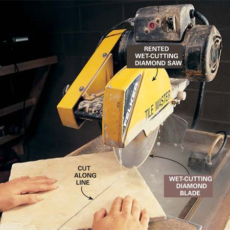 <b>Photo 10: Cut the tile</b></br> Saw along the line with the wet-cutting diamond saw. Wear safety goggles and hearing protection. Steer the tile along the line as you slowly push it into the blade. Make very subtle adjustments to avoid binding the blade.