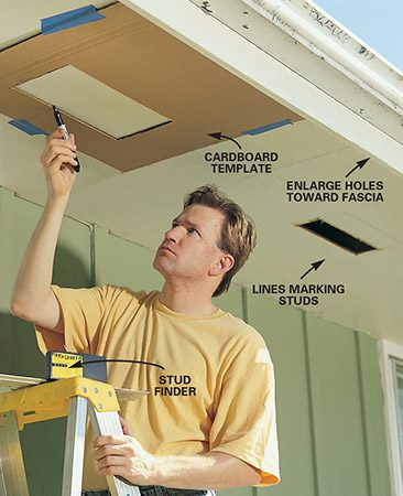 <b>Photo 4: Mark holes for soffit vents</b></br> Butt a cardboard template against the fascia and mark your soffit hole locations. Make the vent hole 1/2 in. smaller on each side than the vent you're installing. If you widen existing holes, widen them toward the fascia, but no closer than 3 in. from the fascia to avoid waves and ripples in the soffit plywood. Position the holes between the rafters at equal intervals. You can find the rafters by locating the nailheads or using a stud finder.