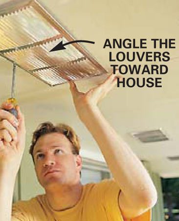 <b>Photo 6: Install the vent</b></br> Install the soffit vent with self-tapping screws. Angle the vent louvers toward the house wall. This prevents blowing snow from entering the vent, and it looks better from the ground.