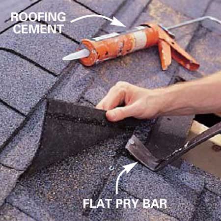 <b>Photo 11: Pry out nails </b></br> Pull nails as necessary so the vent's flange can slide into place. The best time to do this is when the shingles are cool (early morning). Use your flat pry bar to carefully separate the shingles from one another. Apply roofing cement around the perimeter of the hole.