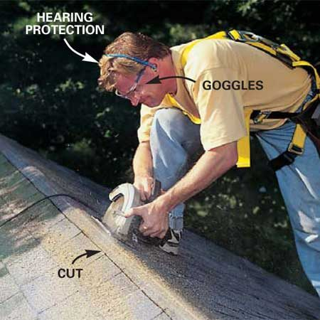 <b>Photo 15: Wear safety gear when you cut the slot</b></br> Cut out a slot in the shingles and the sheathing with a circular saw equipped with an old carbide blade. For a single shingle layer, start with a blade depth of 3/4 in. and make sure it doesn't cut into the rafters. If you have an overhang, stop the slot short so the opening is only over the attic space, not the overhang. If you have a hip roof (no gabled ends), stop the slot 6 in. short of the beginning of the hip. Wear your goggles and hearing protection because you WILL hit nails. Sweep off the sawdust and open the slot with a flat pry bar.