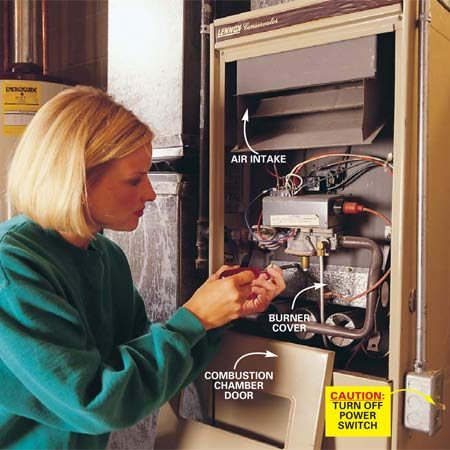 <b>Photo 1: Remove the combustion chamber door</b></br> Flip the electrical power switch to Off. Remove the combustion chamber door by lifting up and pulling it out, and remove the burner cover (if you have one). It's usually held in place by two screws.