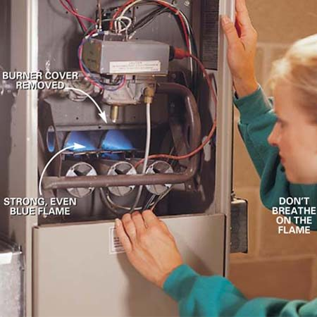 <b>Photo 2: Inspect the burner flames</b></br> Turn  the power switch on and activate the burners by turning up your thermostat.  Inspect the burner flames. The flames should be fairly even and blue. Yellow  flames indicate dirty burners. (Don't breathe on the flames because the extra  oxygen will also make them turn yellow.) Don't adjust the burners yourself.  Call in a pro.