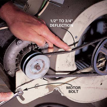 <b>Photo 10: Test fan belts</b></br> The belts on belt-driven blowers need occasional adjustment or replacement. Inspect the drive belt for cracks or frayed areas. A new belt is inexpensive. When you install the new belt, tension it so it deflects 1/2 to 3/4 in.