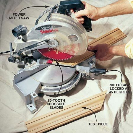 <b>Photo 2: Cut test pieces</b></br> Cut two 12-in. long test pieces of casing at opposite 45-degree angles on the power miter box to check the fit of your casing on the door jamb.
