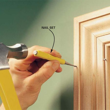 <b>Photo 10: Set the nails</b></br> Tap the nails just below the surface with a hammer and a nail set.
