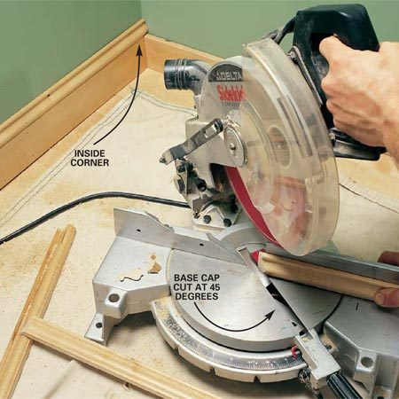 <b>Photo 17: Cope inside corners of base cap</b></br> Run the base cap in the same order as the baseboard. To cope the inside corner of the base cap for a tight fit, first cut one end at a 45-degree angle as if you were cutting an inside miter.