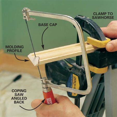 <b>Photo 18: Cut the profile with coping saw</b></br> Use a coping saw to cut along the profile left by the miter. Angle your coping saw back slightly (back cut) to get a tighter fit on the face of the profile.