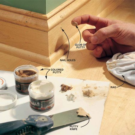 <b>Photo 22: Finish with filler</b></br> Set the nails and fill the holes with colored putty to match the wood stain. We mixed two shades of putty together to get a good color match. Press the putty into the holes with your finger and wipe the excess off with a cloth.
