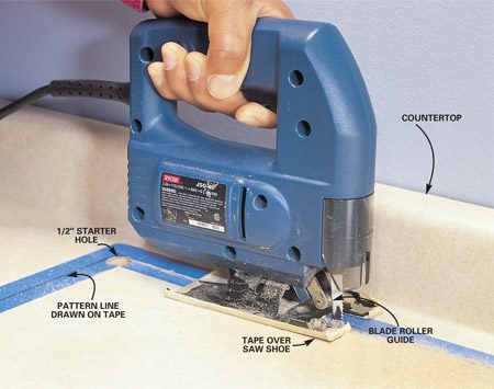 <b>Photo 4: Drill a hole to start the blade</b></br> Make precise, no-chip cuts in laminate by drilling a 1/2-in. starter hole in the countertop for the blade. Use a special laminate blade that cuts only on the downstroke, and follow the cutting line drawn on masking tape. Avoid marring the countertop by taping the bottom of the saw shoe.