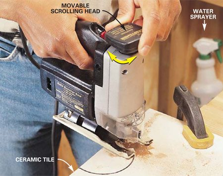 <b>Photo 5: Cut slowly when working with tile</b></br> Use a carbide-grit abrasive blade to make curved cuts in ceramic wall tile that's up to 1/4 in. thick. Speed the work and reduce tile breakage by clamping the tile and using a light mist of water to lubricate the saw cut. Jigsaws that have a movable scrolling head work best to move the blade through tight curves. This is slow work that demands patience, blade changes and relief cuts to open the tightest turns.