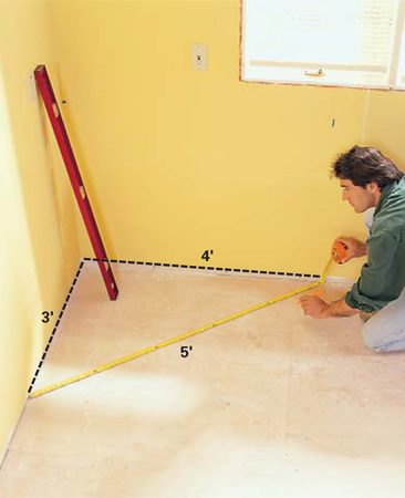 <b>Photo 2: Take note of problem areas</b></br> Look for any irregularities in the room. An out-of-square corner or a hump in the wall will affect how you begin. Check the wall corner to see if the walls are plumb (see text). Use the 3-4-5 triangle rule to check the walls for right angles.