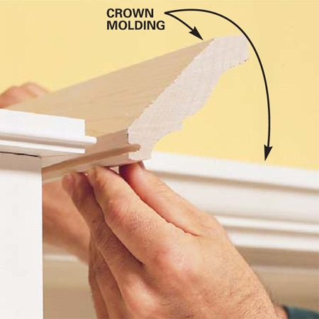 <b>Photo 14: install crown molding </b></br> Cut and fit the crown molding and push it into the tongue of the support strip. Once the fit looks good, use a brad nailer to nail the molding to the support.