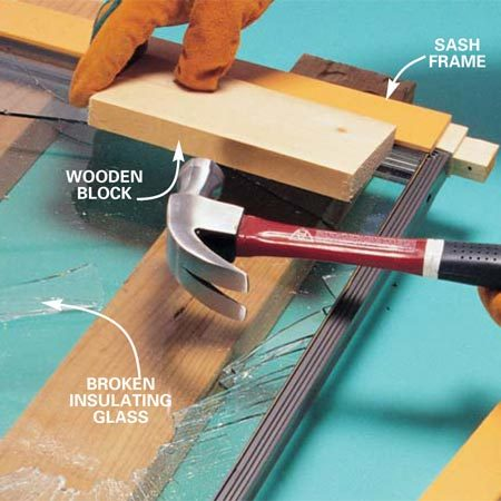 <b>Photo 2: Tap off the frame</b></br> Tap the frame loose from the gasket and glass with a wooden block and hammer. Be careful not to mar or damage the frame. Use a piece of old carpeting if necessary