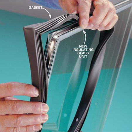 <b>Photo 3: Remove the gasket</b></br> Remove the old gasket and wrap it around the edges of the new insulating glass unit. Then push the frame pieces back together around the gasket, tapping it tight with a hammer if necessary.