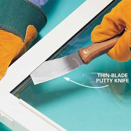 <b>Photo 2: Cut the tape</b></br> Flip the window over. and slice through the tape bond with a thin, flexible putty knife or a utility knife. If you can't slide the knife in, you'll probably have to break out the glass, as shown in Method 3, Photo 3 below .