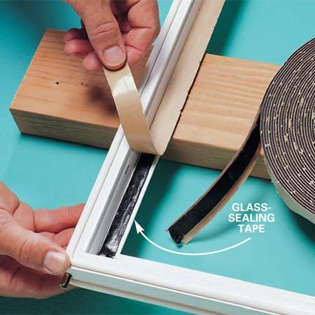 <b>Photo 3: Replace the tape</b></br> Lay the new tape in place after you scrape the old tape and adhesive from the frame and clean off any remaining adhesive with paint thinner or solvent.