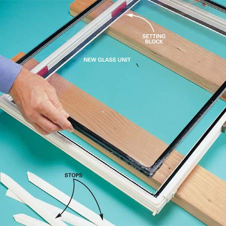 <b>Photo 4: Install the new glass</b></br> Position the glass against the setting blocks and drop it in place. Take care: Once the glass touches the tape, it adheres and can't be adjusted. For accurate placement of a glass panel larger than the one shown, lean the frame against a wall and have a helper steady the frame while you set the bottom edge in place, then tip the panel into the frame. After the glass is in place, replace the stops and caulk any gaps at the corners with clear silicone.