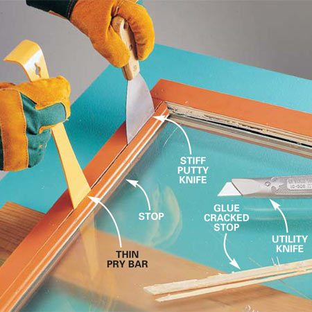 <b>Photo 1: Remove the stops</b></br> Pry off the stops with a thin pry bar and/or stiff putty knives. Work them off gradually to avoid breaking them and damaging the frame