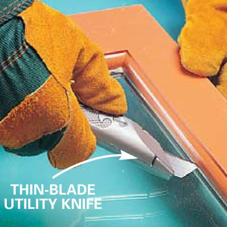 <b>Photo 2: Cut the caulk</b></br> Flip the window over and try to cut the caulk with a utility knife. Sometimes the caulk is weak, and the glass comes free. But usually it won't, and you'll have to break the glass, as in Photos 3 and 4.