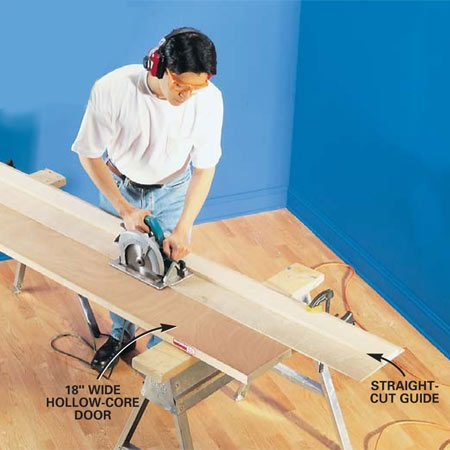 <b>Photo 2: Cut the door</b></br> Cut the door blank lengthwise after clamping a straightedge guide to the door. Be sure to use a 40-tooth carbide blade for a smooth cut.