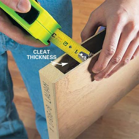 <b>Photo 3: Measure to determine cleat thickness</b></br> Measure the space between the outer veneers of the door and cut cleats from a 2x4 to this thickness. Our measurement was 1-3/32 in. Use straight, dry lumber for cleats.